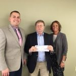 Realtors Board Presents Check for Housing Study
